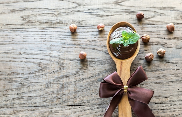 Wooden spoon of chocolate cream with fresh mint
