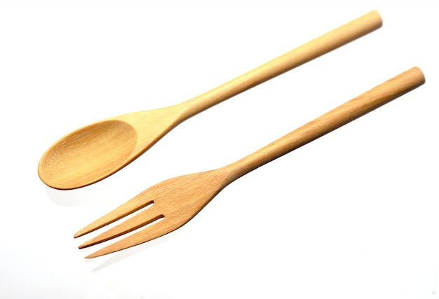 Wooden spoon and fork isolated on white