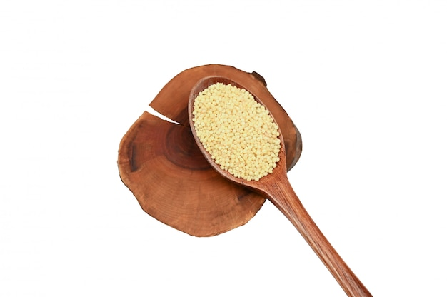 Wooden spoon and millet