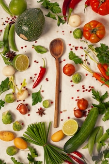 Wooden spoon and organic vegetables