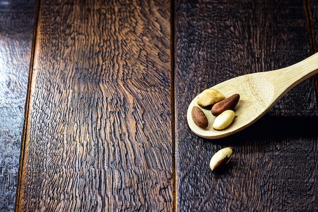 Wooden spoon with brazil nuts, brazilian nuts used in cooking