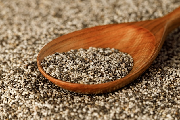 Wooden spoon with chia seeds , copy space