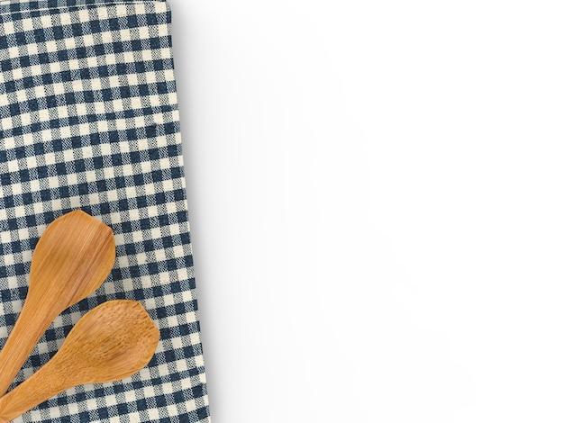 Деревянная ложка с салфеткой на белом фоне