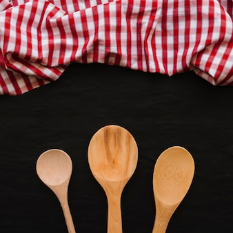 Wooden spoons near napkin