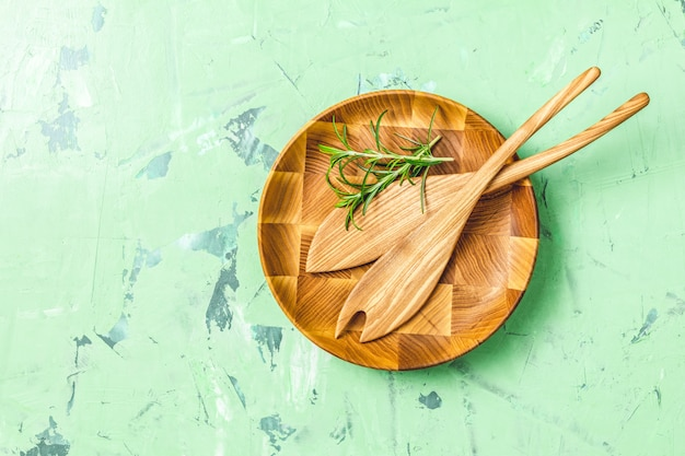 Wooden spoons for salad in wooden plate