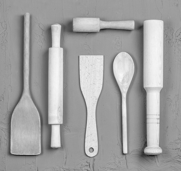The wooden spoons, spatulas and a rolling pin. close up