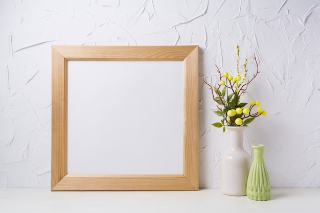 Wooden square frame mockup with yellow decoration
