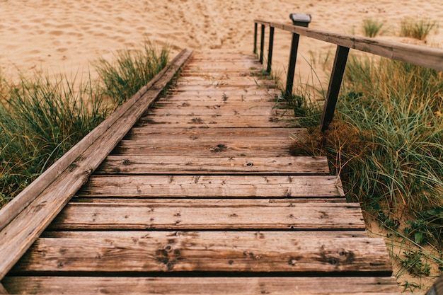 Wooden stairs going down to the beach
