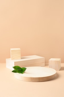 Wooden stands for product on beige background. vertical mock up for design .