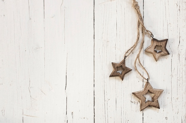 Wooden stars for christmas tree over white wooden background