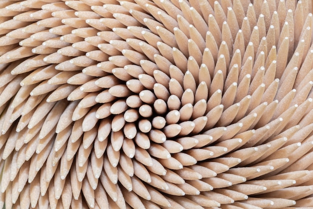 Wooden sticks for cleaning and hygiene of teeth close-up