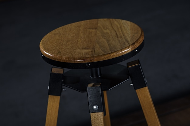 Wooden stool with metal legs