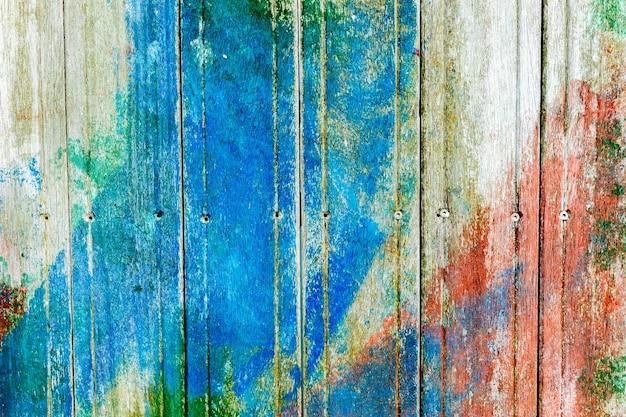 산산조각이 난 페인트로 덮여있는 나무 표면. 정통 질감