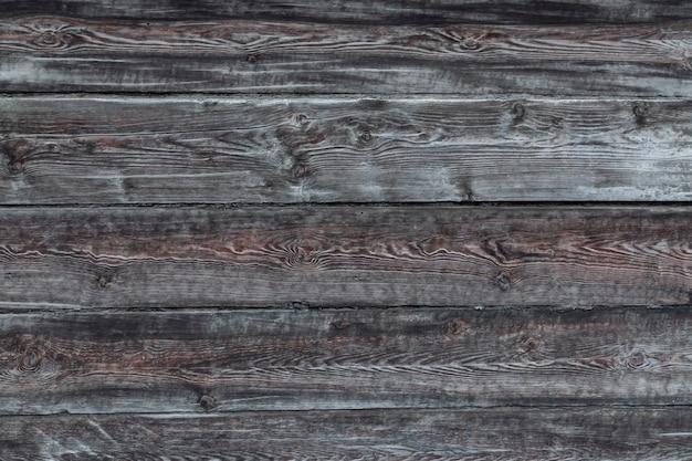 Деревянная поверхность из горизонтальных старых темно-серых досок текстура древесины с копией пространства