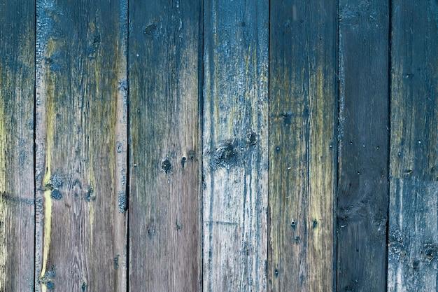 Деревянная поверхность из вертикальных серо-зеленых досок текстура древесины с копией пространства