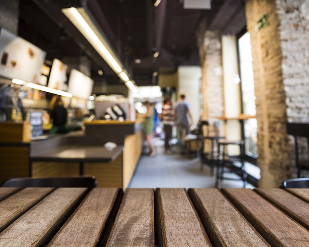 Wooden surface looking out to bar scene