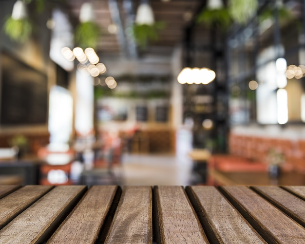 Wooden surface looking out to blurred restaurant