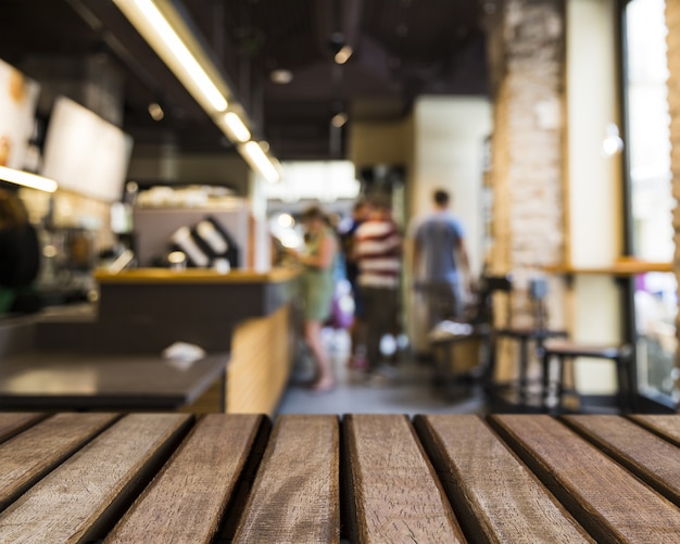 Wooden surface looking out to people in bar