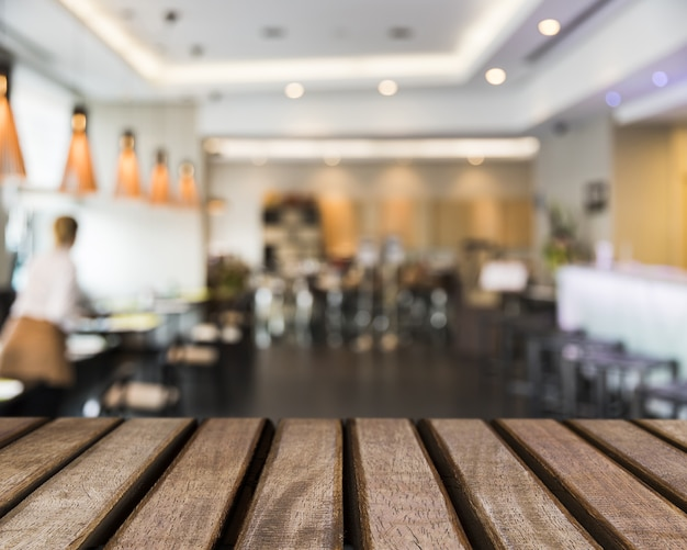 Wooden surface looking out to restaurant scene