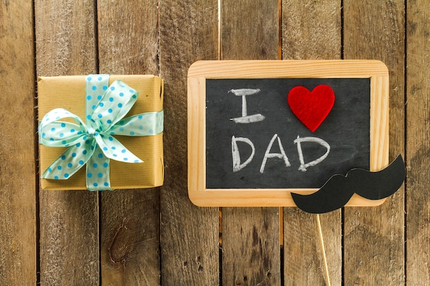 Wooden surface with father's day message and gift