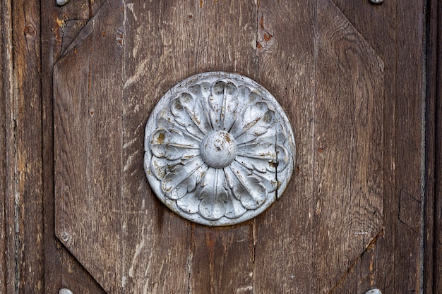 Wooden surface with a round bas-relief of silver color. high quality photo
