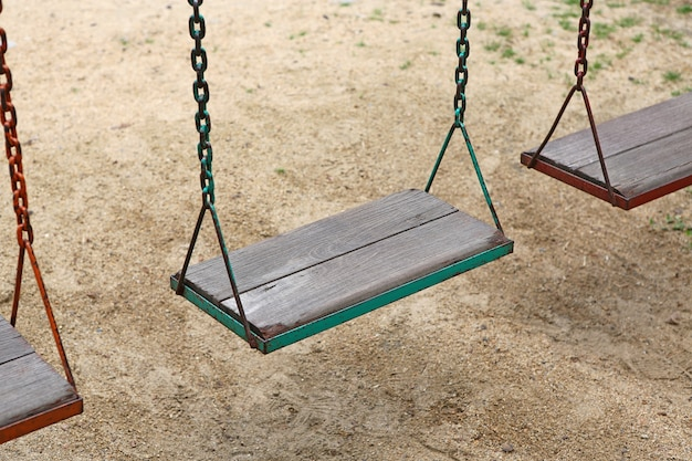 Wooden swing chair in park