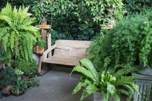 Wooden swing seat in outdoor garden