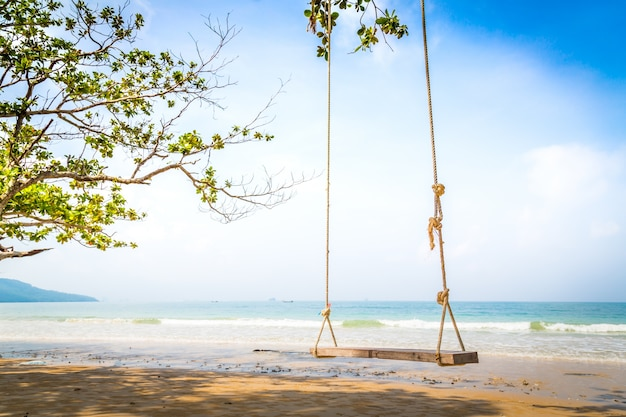 Wooden swing on a sunny day