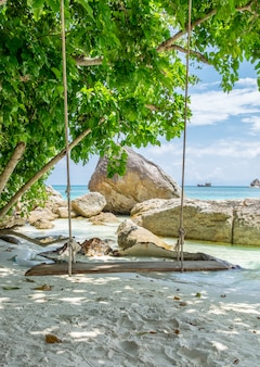 Wooden swing on white sand shady at lipe