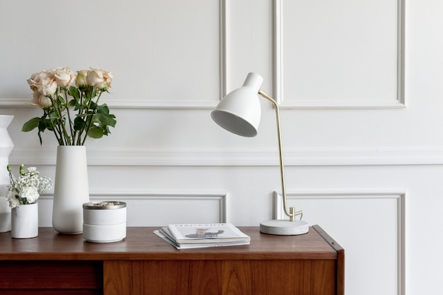 Wooden table against a white wall