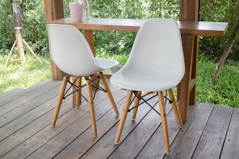 Wooden table and modern chair