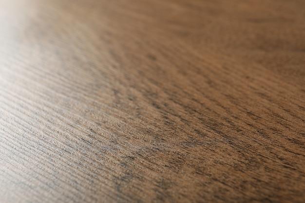 木製のテーブルの背景、クローズアップ。テキストのためのスペース