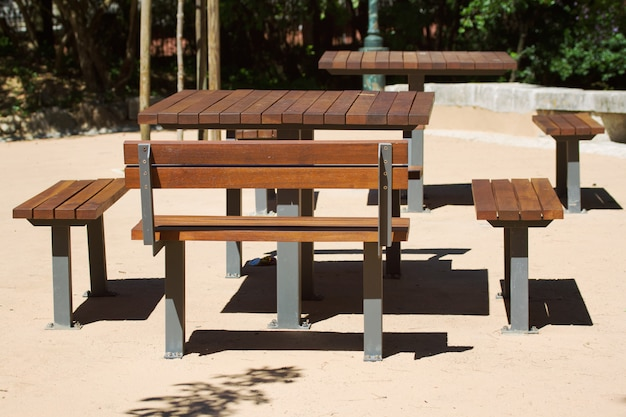 Wooden table and bench in the city park
