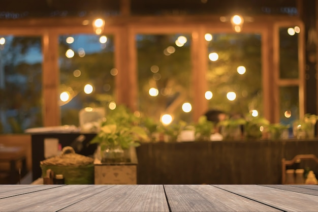 Wooden table blank in front of blurred restaurant background