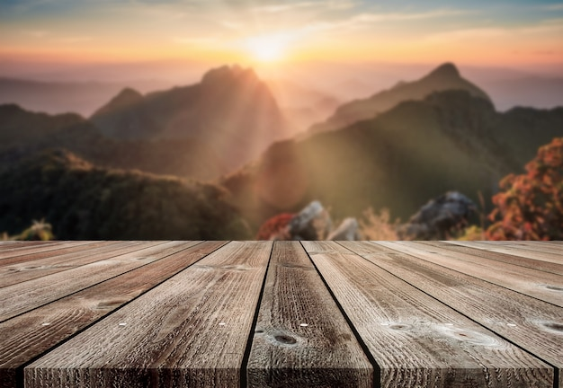 Wooden table at blurred sunset on mountain