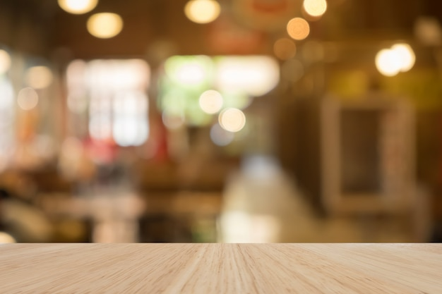 Wooden table of brown in front blurred background, use for presentation product and advertising