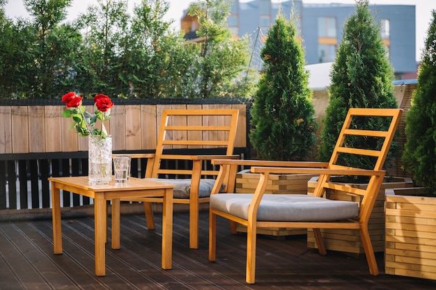 Wooden table and chairs at a patio on a rooftop