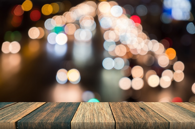 Wooden table in front blurred background, bokeh