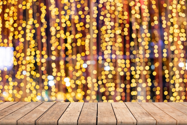 Wooden table on front blurred colorful bokeh background