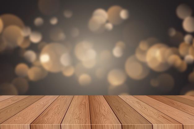 焦点がぼけたクリスマスのボケ味のライトを見渡す木製のテーブル