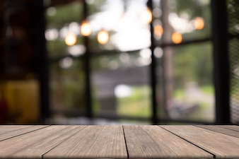 Wooden table on front blurred background