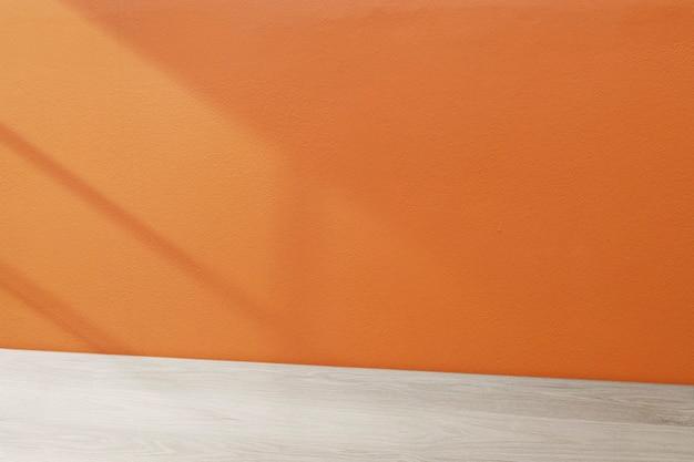 Sfondo del prodotto da tavolo in legno, design della parete arancione