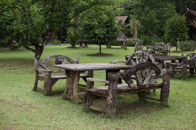 Wooden table set in green garden