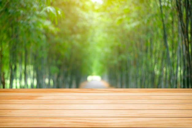 Wooden table texture on green nature background