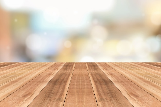 Wooden table top against blurred cafe background