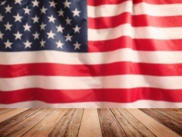 Wooden table top over blurry background of usa flag, vintage filter effect.