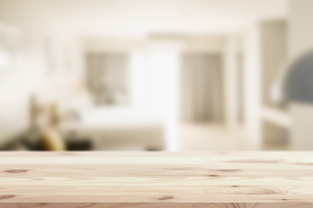 Wooden table top in home or hotel bed room blur background for montage sleeping or house products display or backdrop design layout.