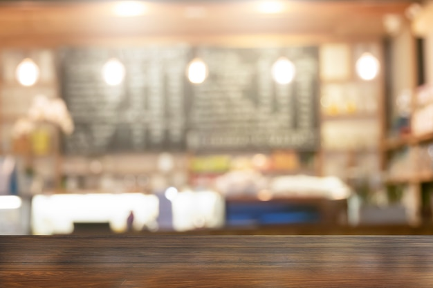 Wooden table top with view blurred beverages coffee bar backdrop