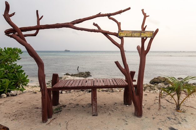 Wooden table on a tropical beach