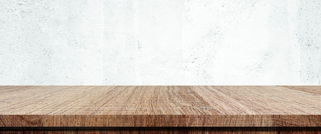 Wooden table and white wall